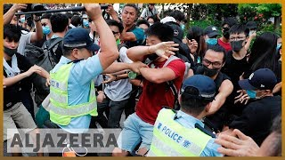 Hong Kong protesters take aim at Chinese traders