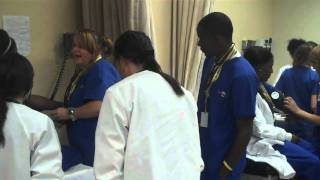 Medical Assisting Students Learning To Take Vital Signs - Charter College Lancaster