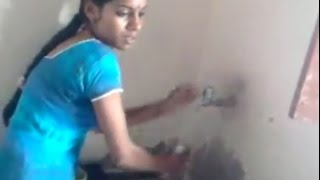 Indian young  girl in her kitchen at home