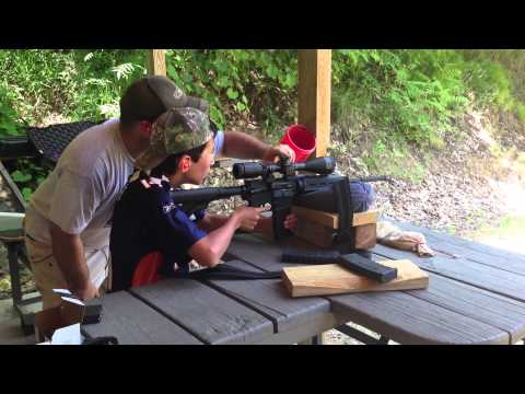 Andrew shoots AR-15 .223 cal assault rifle