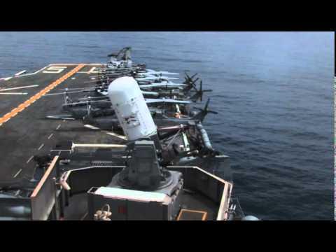 Phalanx CIWS Gun Firing from US Amphibious Assault Ship Close in Weapon System Gatling Gun in Action
