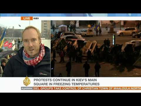 Ukraine PM warns of a coup as protests rage