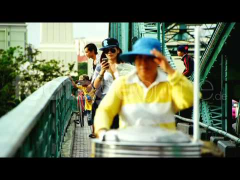 Pedestrian bridge over river in Bangkok footage 013976