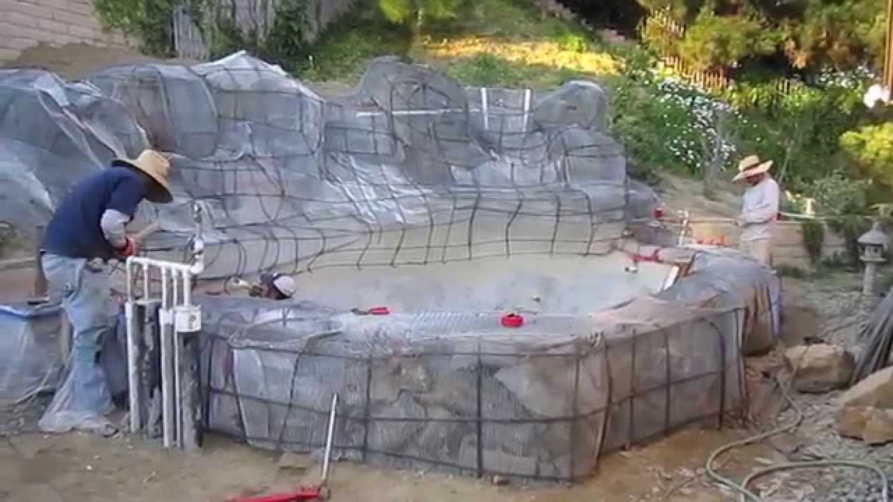 Koi pond construction part 5 faux artificial boulders for Concrete fish pond construction and design