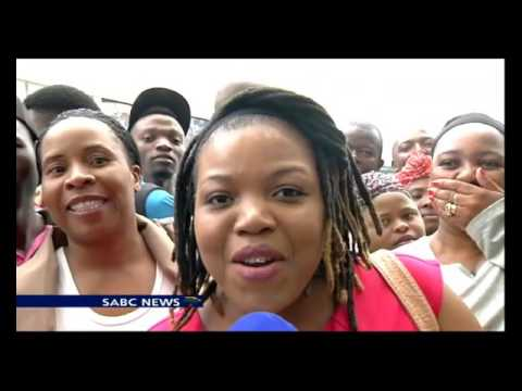 Shoppers react to the opening of the Mall of Africa
