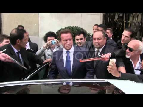 EXCLUSIVE: Arnold Schwarzenegger coming out of his hotel to go to Elysees in Paris