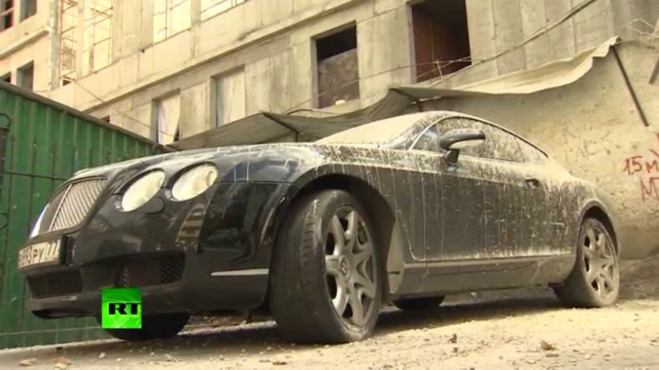 Only In Russia Bentley Supercar Caked In Concrete In