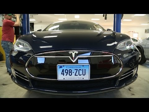 CR Tesla updated with titanium plate - will it stop battery fires? I Consumer Reports