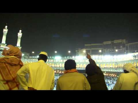 White Birds Flying Above Kaabah While Heavy Rain 2011