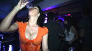 Sexy busty woman drinks beer