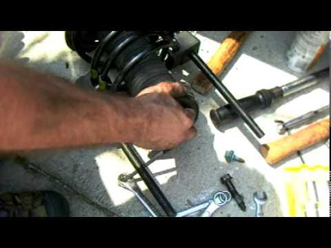 Замена передней стойки амортизатора MAZDA 3, Видео!