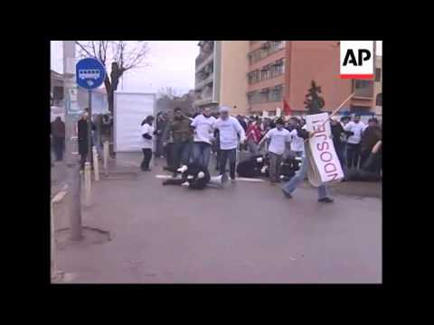 Riot police fire tear gas to break up protest by ethnic Albanians