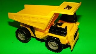 Trucks for children: toy construction trucks collection and rainbow rice sensory box
