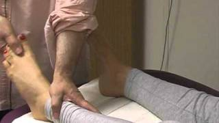 Asian massage techniques on table: the foot