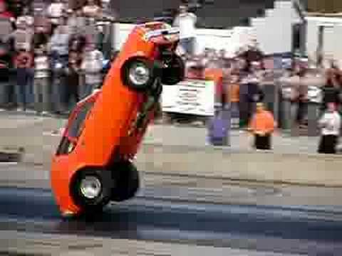 Please Read the Video Info *** Crazy wheelstand from an AMC Gremlin? Has to be seen to be believed. Be sure to pause it and observe that he had all 4 wheels off the ground. Car was on...