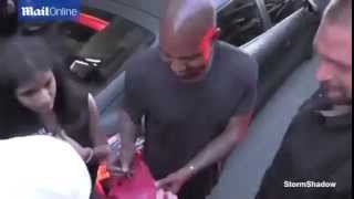 Kanye West Signs Fake Red October Yeezys