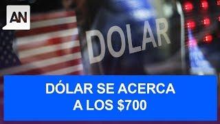 El dólar queda al borde de los 700 pesos