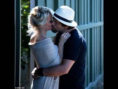 Pamela Anderson spotted kissing husband Rick Salomon... just one week after it was revealed she file