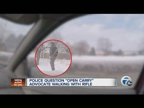 Police question open carry advocate walking with rifle