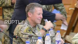 Afghanistan: NATO meeting shows moments before attack left police chief dead