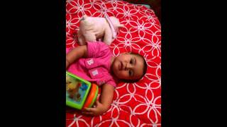 Nahya playing with her toy