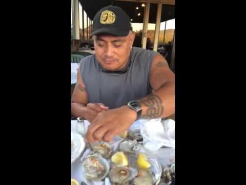 Man Eats Oysters the Island style.... U won't believe it