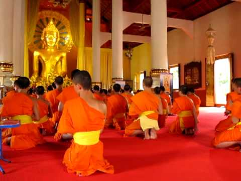 Buddhist Monks praying in Buddhist Praying At Temple