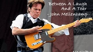 Watch John Mellencamp Between A Laugh And A Tear video