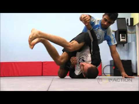 Marcelo Garcia In Action - Hip Roll Escape vs Side Control Image 1