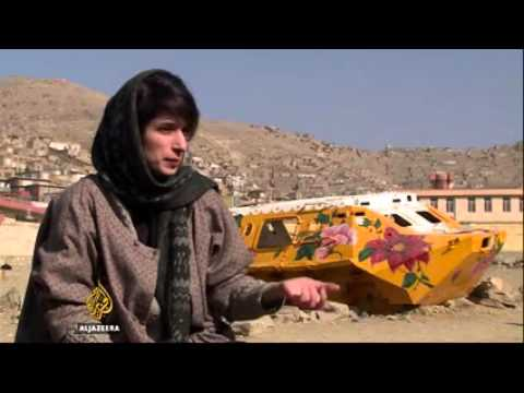 Afghan artist turns tanks into her canvas