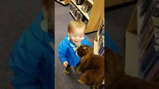 1 year old treats squirrel puppet like it's real