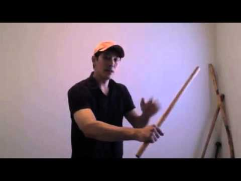 single Eskrima stick basic exercise parking the free hand