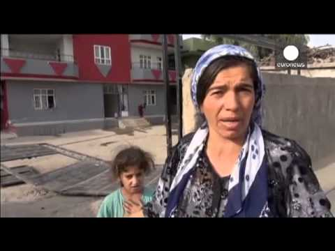 Residents inspect damage as Cizre curfew lifted in Turkey