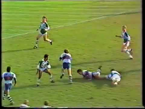 Joe Kilroy finishes a typical Brothers backline movement from 1987 against the Ipswich Jets at Lang Park.