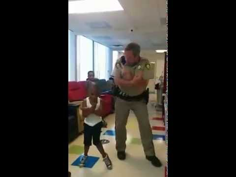 Nev. cop busts a move with boy fighting cancer