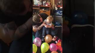My son with CP loving popping his balloons!