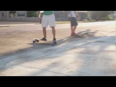 Longboarding - Nollie pop, 50 50's, and Big spins (short)