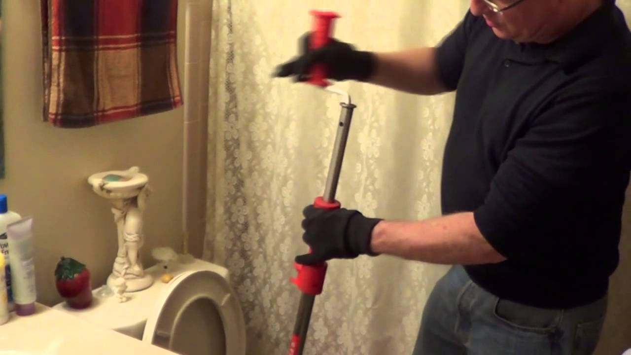 how to unclog a toilet using a toilet auger youtube. Black Bedroom Furniture Sets. Home Design Ideas
