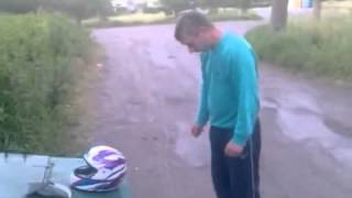 Drunk guy breaking a brick with his head  Then tries the same TO a helmet
