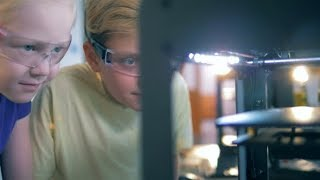Kids Looking at a a Modern School 3D Printer Working. Modern Education Concept   Stock Footage -