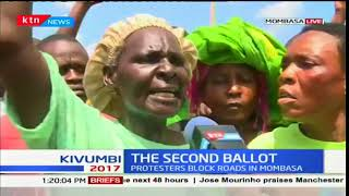 Mombasa residents chant 'No Raila No Elections' as they protest the fresh polls