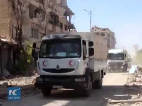 First aid enters Syrian besieged city near Damascus since 2012
