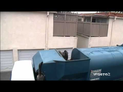 garbage truck lifting trash cans in orange county california at the united states of america