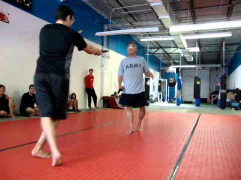 Eskrima Knife Fight with Shock Knives Image 1