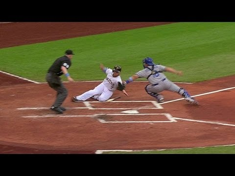 Punto throws out Presley at home plate