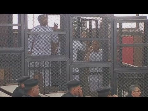 Behind Bars: Three Al Jazeera journalists jailed for seven years