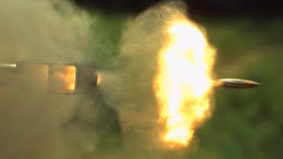 Firing a .50 Cal Sniper Rifle in Slow Motion - The Slow Mo Guys