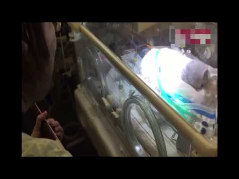Heartbreaking video of father singing 'Blackbird' to comfort dying baby son after wife died...