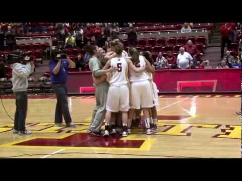 Iowa State Basketball Player Engaged at Half Court After Win