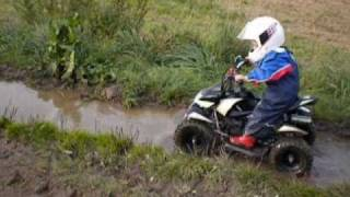 Kid (Till) 3 years with Quad in the mud.